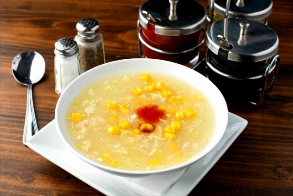 Chicken broth combined with corn and egg, and seasoned with black pepper