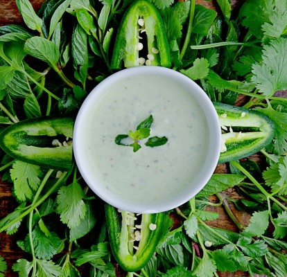 Homemade yogurt mixed with finely chopped cucumbers, bell pepper, cilantro, green chili and mint